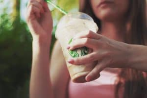 Woman holding expensive Starbucks drink