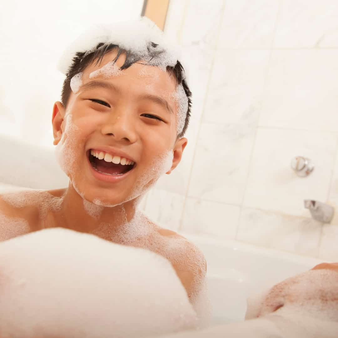 child taking epsom salt bath for constipation