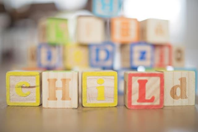 child written with toy blocks