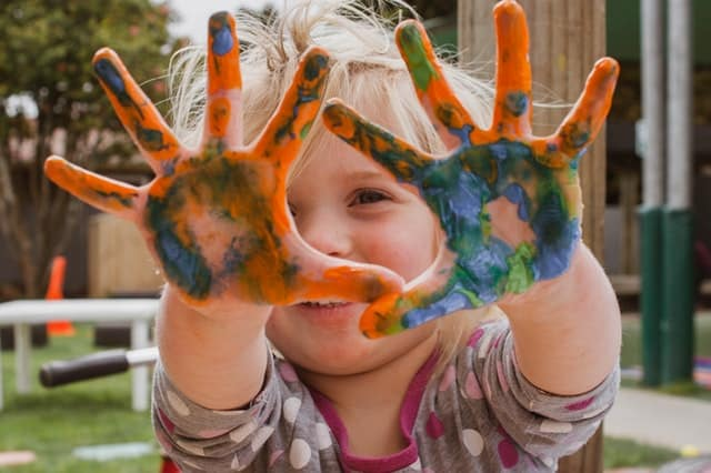 toddler with painted hands
