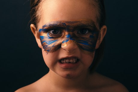 Child with warrior paint