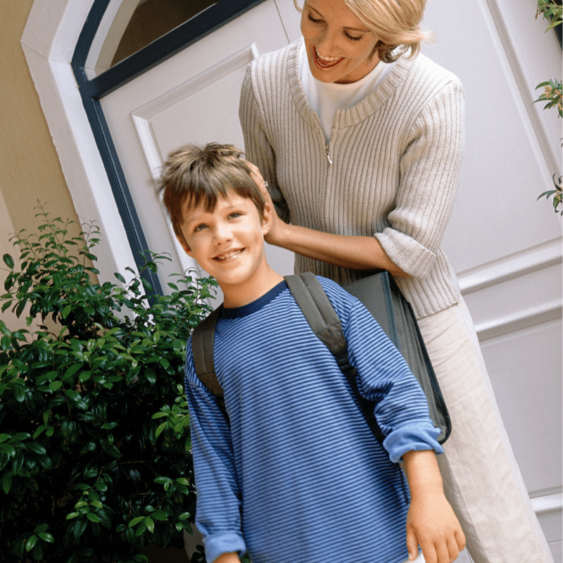 Mom with backpack leaving door with Mom