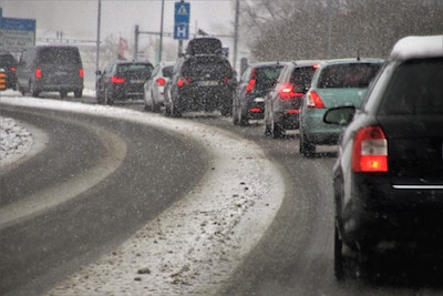 cars stuck in traffic in the winter