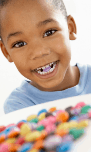 Child eating colourful candy