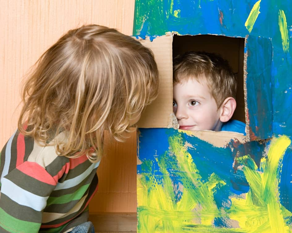 Two boys playing in a box