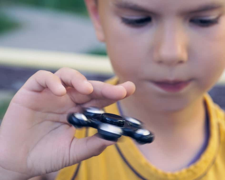 Child holding fidget spinner